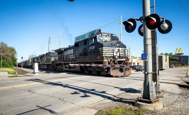 A train moves through the rail crossing at Tillotson Avenue on Saturday, May 8. Trains have been increasingly blocking crossings throughout the city according to officials.