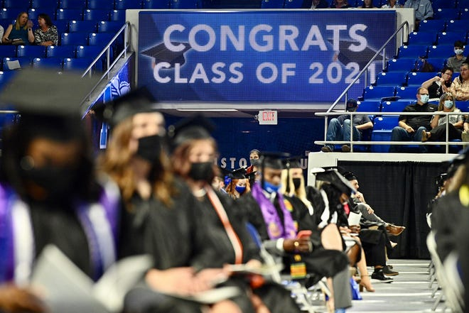 A scoreboard in MTSU's Murphy Center carries a special message during a May 7, 2021 ceremony. More than 825 students are expected to receive their degrees on Saturday for the summer ceremony.