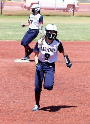Deming High kept the bases packed during Saturday's District 3-5A double header against the visiting Las Cruces High Bulldawgs. Pilar Garcia (9) sprints to third base ahead of Jocelyn Aguayo (7). The 'Cats swept the Bulldawgs, 18-0 and 15-0 on Saturday.