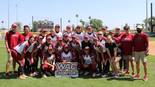 The New Mexico State softball team poses for a photo after earning a 9-3 win over California Baptist and securing sole possession of the WAC regular-season title on Saturday, May 8, 2021, in Riverside, California.