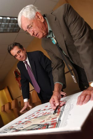 Kevin Boberg, left, and Garrey Carruthers look over an architectural rendering of the new Arrowhead Research Park in 2007, when Carruthers was dean of NMSU's College of Business and Boberg was the college's Carruthers Chair in Economic Development.