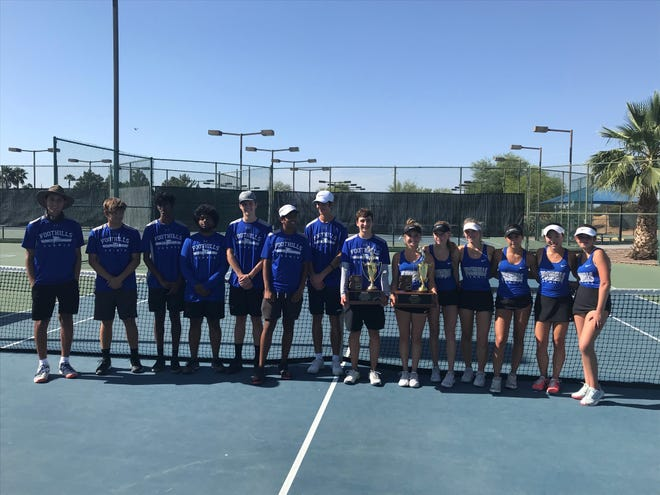 May 8, 2021; Catalina Foothills boys and girls tennis teams stand on a tennis court at Paseo Racquet Center holding up their 2021 AIA Division II state team championship trophies in Glendale, Ariz.