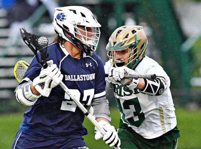 Dallastown's Mason Bowman moves the ball down the field while York Catholic's Dom Demarco defends during boys' lacrosse action at York Catholic High School in York City, Friday, May 7, 2021. Dallastown would win the game 13-6. Dawn J. Sagert photo