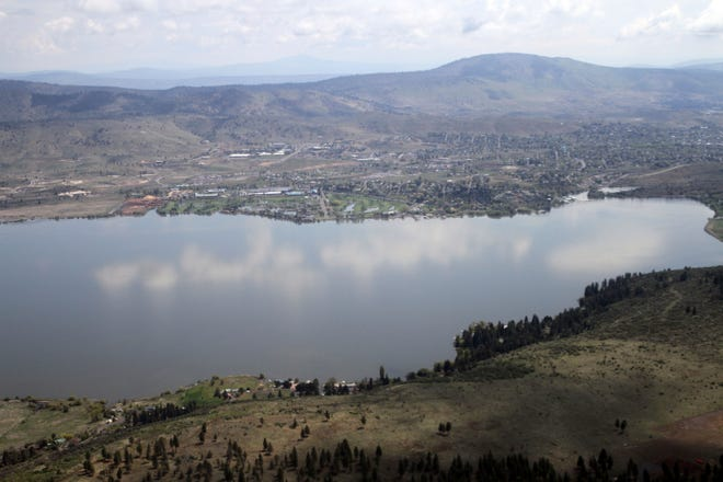 This May 7, 2013, file photo shows Klamath Falls in Oregon on the far side of Upper Klamath Lake. A federal judge has ruled against the Klamath Tribes in a lawsuit that accuses the U.S. Bureau of Reclamation of violating the Endangered Species Act by letting water levels fall too low for sucker fish to spawn in a key lake that also feeds an elaborate irrigation system along the Oregon-California border. The ruling, reported Friday, May 7, 2021, by the Herald and News in Klamath Falls, comes as the region confronts one of the driest years in memory.