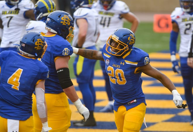 South Dakota State's Pierre Strong, Jr. celebrates a touchdown with his teammates during the FCS semifinals against Delaware on Saturday, May 8, 2021 at Dana J. Dykhouse stadium in Brookings.