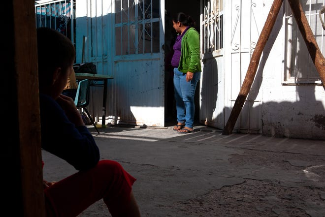 Alma steps out of the dormitory at El Buen Samaritano shelter in Juárez. She reached the US-Mexico border with her son, who she says fainted from extreme temperatures and lack of air inside the vehicle in which they traveled. (Corrie Boudreaux/El Paso Matters)