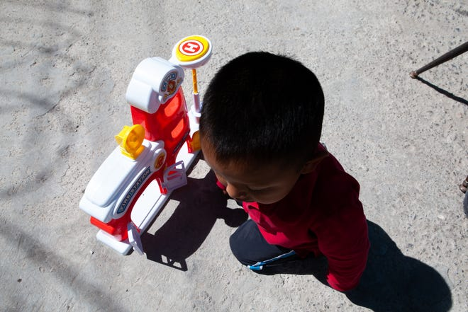 Melinda's son, Samuel, plays at the migrant shelter where the family lives. (Corrie Boudreaux/El Paso