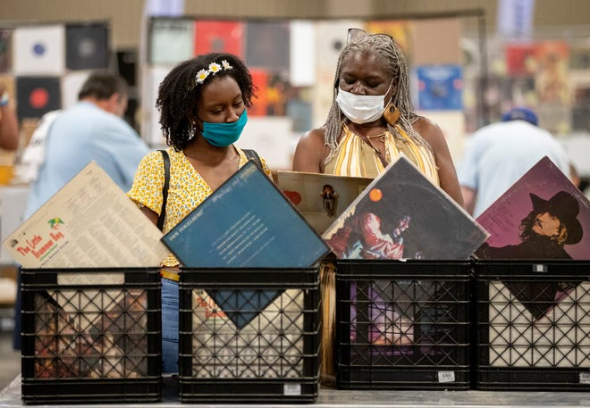 Jamera Gilbreath and her mother, Janice Gilbreath, shop for records during the Austin Record Convention at the Palmer Events Center on May 9. A  barometer of local business activity shows the local economy continues to recover from the coronavirus pandemic.