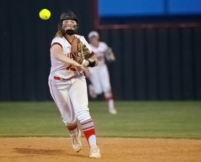 Lake Travis' Toni Williams throws the ball to first base for the out during the Cavaliers' 7-5 win Friday against Schertz Clemens. The victory was a part of two straight Lake Travis won to advance to the regional quarterfinals of the Class 6A playoffs.