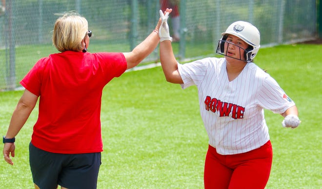 Bowie's Emma Solis high-fives her coach, Liz Wissel, while trotting home after a home run against the Steele Knights during the Class 6A UIL area -round playoff series Saturday at Westlake High School. Bowie won two games on Saturday to eliminate Steele and advance to a regional-quarterfinal series against Lake Travis.