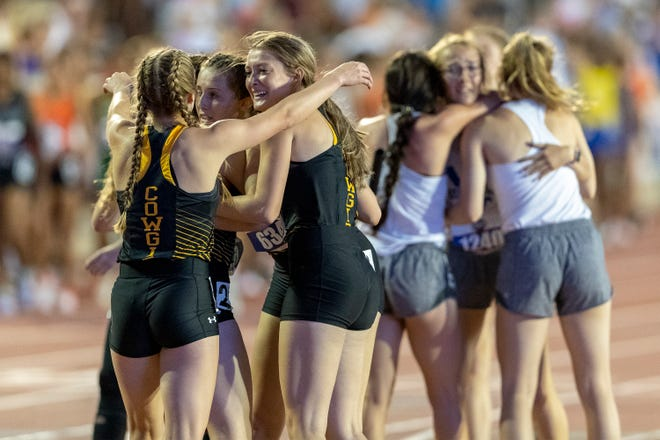 Happy and Wildorado celebrate after finishing the Class 1A girls 1,600-meter relay during the UIL state track and field meet Saturday at Mike A. Myers Stadium in Austin.
