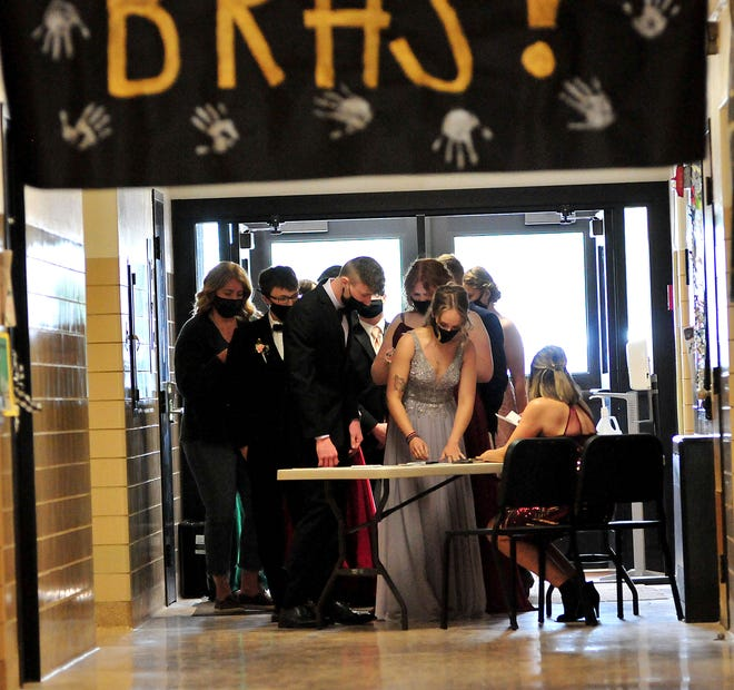 Students sign in before Black River High School's prom grand march at the high school Saturday, May 8, 2021.