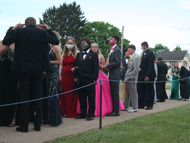 Students wait in line to get into the Loudonville prom at Loudonville High School on Saturday, May 8, 2021