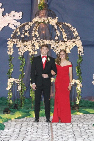 Hal Huber escorts Cierra Hershey on Saturday during the grand march at Northwestern High School for the school's prom.