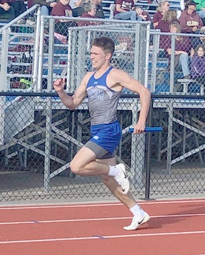 Boonville junior Luke Green runs a leg in the 4 x 400 meter relay Thursday during the Tri-County Conference Track Meet in California.