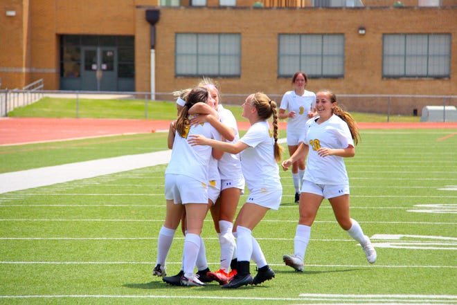 Brooklyn Hunter is embraced by multiple teammates after her goal in the 71st minute in the 5-1 win over Mulvane on Saturday afternoon in the North Cup Finals.