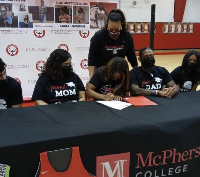 Robstown senior Kiara Hawkins signed a letter of intent to play basketball at McPherson College on Friday in Robstown.