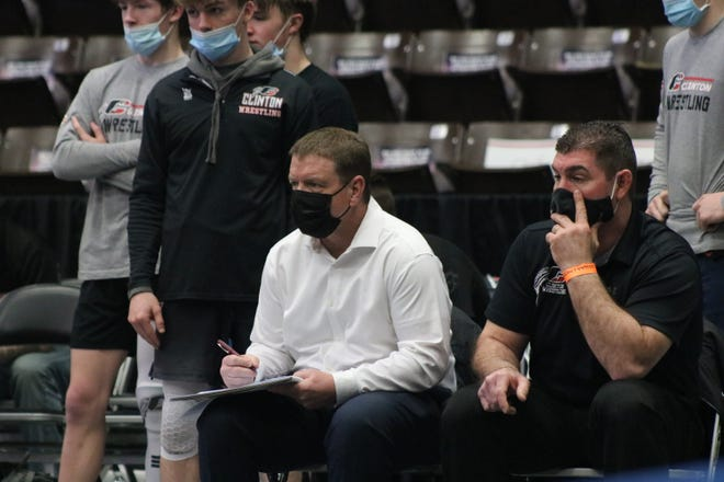 Clinton co-head coaches Jeff Rolland and Casey Randolph look on with their team during a match at the Division 4 team state championships at the Wings Event Center in Kalamazoo on Tuesday, March 30.