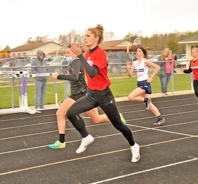 Coldwater's Chloe Schaale powers her way down the track on her way to a first place finish in the 100 meter dash Friday at the Wildcat Booster Invite
