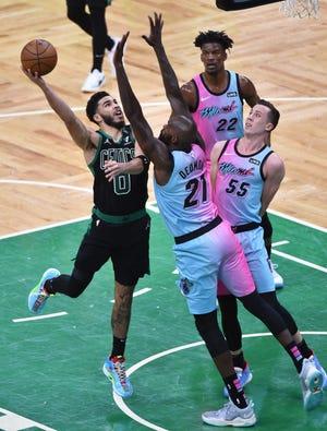 May 9, 2021; Boston, Massachusetts, USA; Boston Celtics forward Jayson Tatum (0) gets fouled as he shoots the ball by Miami Heat center Dewayne Dedmon (21) during the second half at TD Garden.