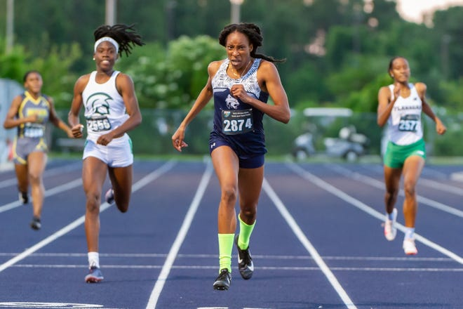 North Port High's Kylah Buckle races to first place in the girls 400 meter run at the FHSSA track and field championships at UNF Hodges Stadium on Saturday.