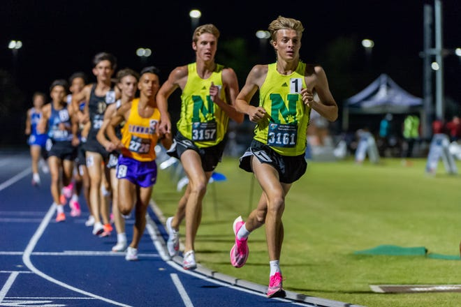 Rheinhardt Harrison and Anderson Ball of Nease compete in the boys 3200 meter run Saturday night. The teammates finished first and second.