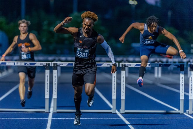 Kevin Davis Jr. of Atlantic Coast wins the boys 300-meter hurdles on Saturday night at UNF.