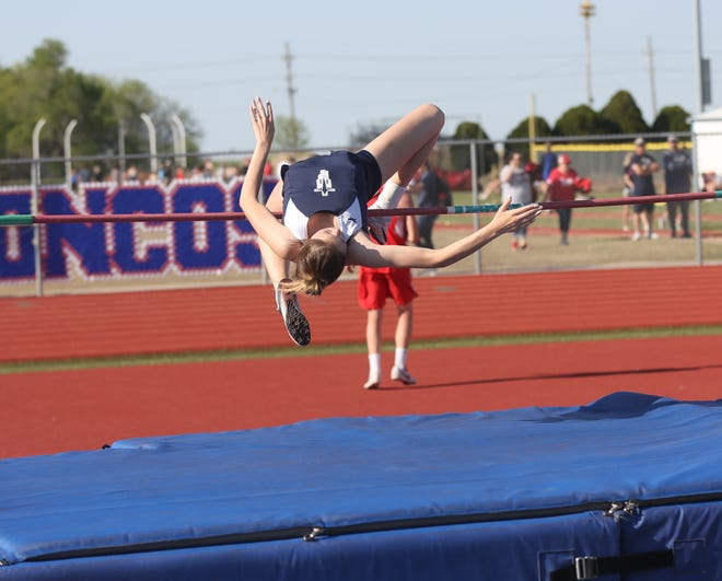 TMP's Kassidi Yost clears the bar in the high jump on Friday at the Russell Relays.