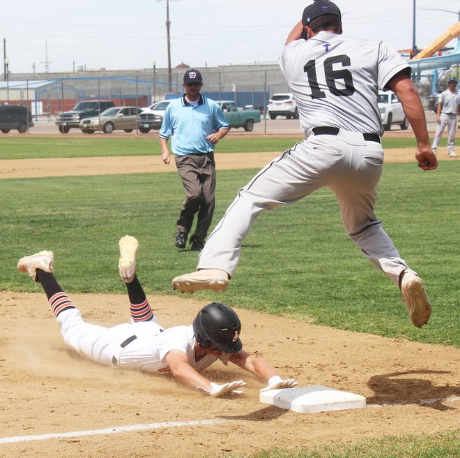 La Junta High School's Trevor Johnston slides into third base following a wild pitch in the first game of a doubleheader against Lutheran on Saturday.
