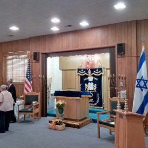 This Photo shows the bima at Monroe's Temple B'nai Israel. In Jewish synagogues, the bima (or bimah) is located in the building's center. It is for Torah reading during services.