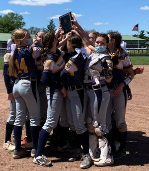 Whiteford's softball team celebrates after winning its own invitational Saturday.
