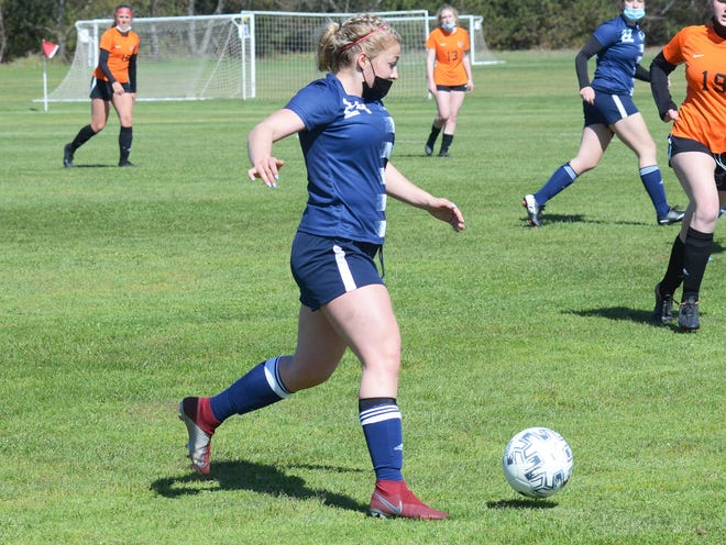 Petoskey's Emma Nicholson pushes the ball into Armada territory during the opening game on Saturday.