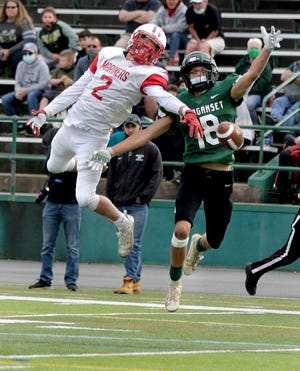 Narragansett's Tyler Poirier (left, in last spring's D-III Super Bowl) had a big day Saturday, catching two long TD passes to help the Mariners take down Central Falls/BVP.