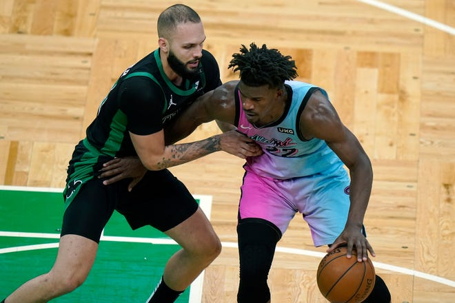 The Celtics' Evan Fournier, left, defends against Heat's Jimmy Butler in the second half of Sunday's game.