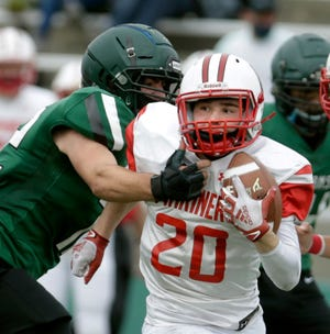 Brady Butler, Narragansett running back and game MVP, tries to break the grasp of Ponaganset's Nicolas Viner during second-half action in the Division IV Super Bowl on Sunday. For full coverage of Sunday night's Division II Super Bowl between St. Raphael and Barrington, go to providencejournal.com/sports.