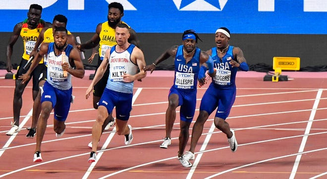 Unites States' Michael Rodgers, right, hands the baton to Cravon Gillespie during the men's 4x100-meter relay at the 2019 World Athletics Outdoor Championships in Doha, Qatar. (AP Photo/Martin Meissner)