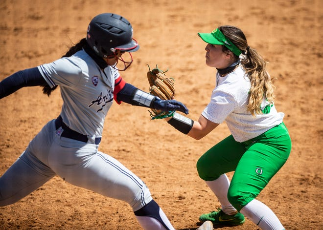 University of Arizona's Dejah Mulipola (8) sprints to first base where University of Oregon (28) Shaye Bowden waits for the ball that sends Mulipola back to the dugout at Jane Sanders Stadium on Sunday, May 9, 2021.