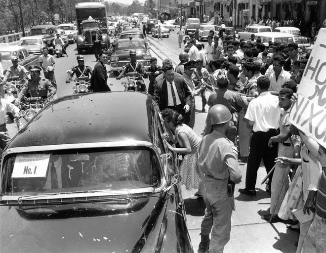 Venezuelan protesters shout as they close in on Vice President Richard Nixon's car as the motorcade proceeds through a Caracas street, May 13, 1958. The Nixon motorcade was the target of rocks, debris and heavy sticks.
