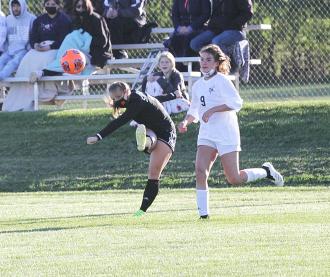 Allison Landess sends a ball across the pitch to a teammate near the goal box on Friday night against Niles.