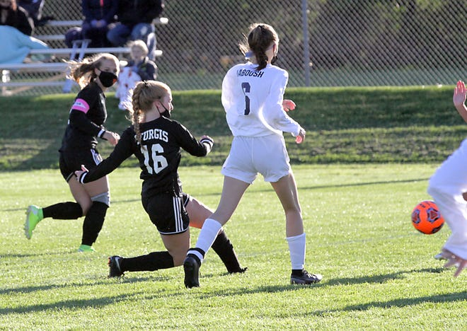 Emily Herman of Sturgis boots a ball on target against Niles in prep soccer action on Friday.