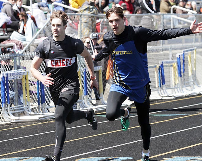 White Pigeon's Dominic Pant and Centreville's Tyler Swanwick cross the finish line in the 800 relay on Saturday. Swanwick narrowly crossed the line first.