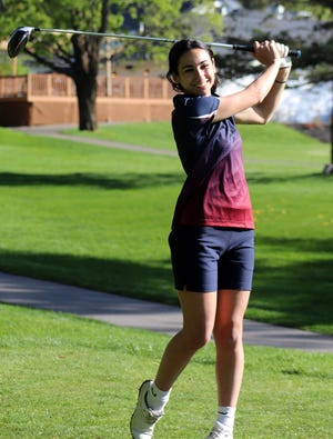 Westboro senior captain Elise Arvanigian practices her swing on the eighth tee at Westboro Country Club recently.