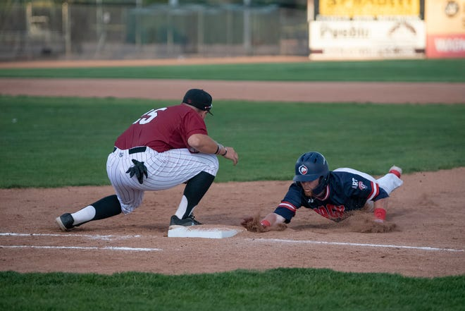 Colorado State University Pueblo junior Aidan Welch, right, slides back into first base during the Pack the Park game against Colorado Mesa on Saturday May 8, 2021.