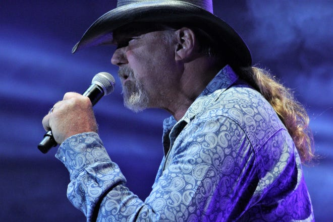 Trace Adkins, all 6-foot-6 of him and his hair in a pony tail, sang many of hits and new music, too, in his first full-blown concert in more than a year during a show Saturday night at the Taylor County Coliseum that included Johnny Lee.