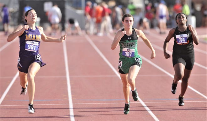 Blackwell's Kiley Cummings, center, races to a second-place finish in the Class 1A 200 meters at the state track meet Saturday in Austin.
