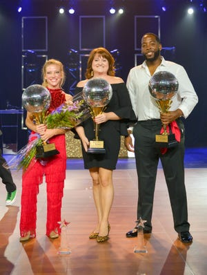 Carrie-Brown Campbell and Brian James, seen here with their choreographer Carol Ann Williams in the middle, won two trophies at Dancing with the STARs on Thursday - the Grand Champions trophy and the People's Choice.