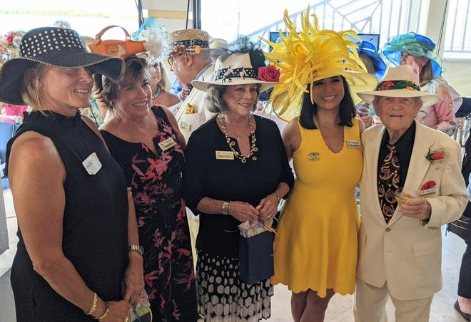 Winners of the Marco Island Yacht Club Kentucky Derby hat contest, from left, Mary Beth Apolzan, Deb deVries, Irene Soden, Maribel Aber and, Don Mills.