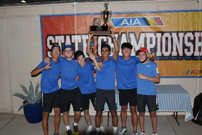 May 8, 2021; Phoenix Country Day holds up the 2021 AIA Division III boys tennis state team championship trophy at Paseo Racquet Center in Glendale, Ariz.