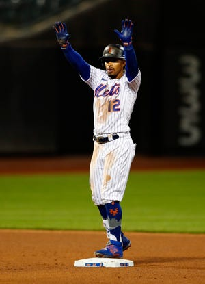 New York Mets' Francisco Lindor gestures after hitting a double against the Arizona Diamondbacks during the fifth inning of a baseball game Saturday, May 8, 2021, in New York. (AP Photo/Noah K. Murray)