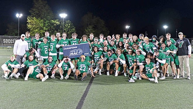 The York College men's lacrosse team is shown after winning the MAC Commonwealth title on Saturday night.